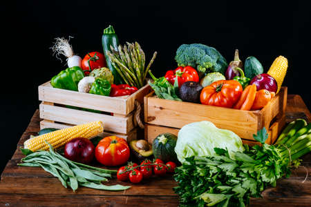 Boxes full of different types of healthy organic vegetables for a vegan diet