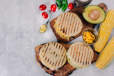 Top view of arepas, breakfast in Colombia and Venezuela, made with corn flour Stock Photo