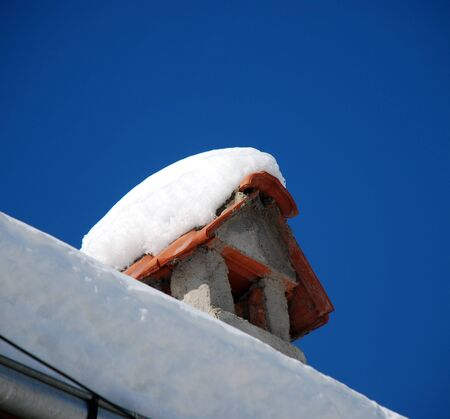 snow covered  chimney photo