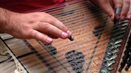 Playing Kanun, a Turkish instrument Stock Photo