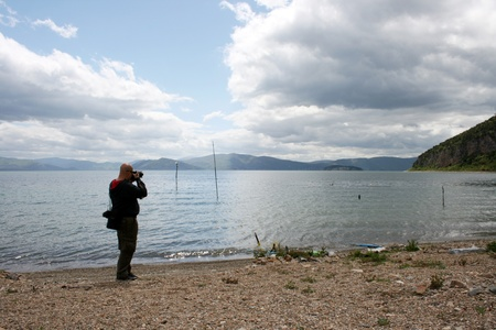 photographer picturing lake prespa photo