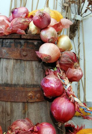 red onions on a barrel photo