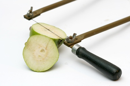 cutting green pear photo