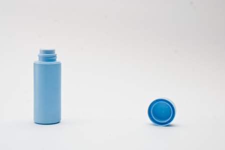 blue baby powder bottle isolated photo