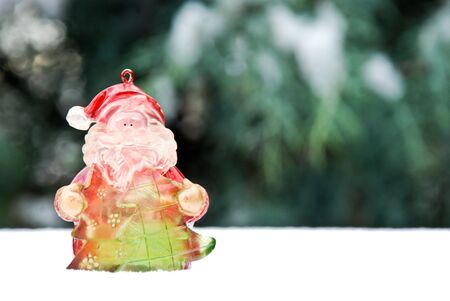 christmass: Christmass background, santa claus toy  on snow
