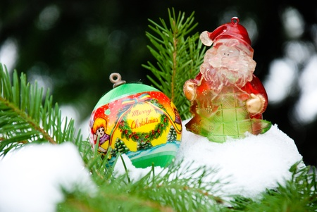 christmass: Christmass background, ball and santa  on snow and pine tree Stock Photo