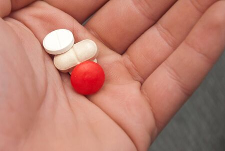 hand holding pills photo