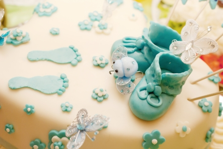 baby boy  bithday cake with sweet cute shoes on it