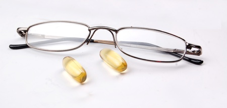 doctor fish wellness fish: omega 3 pills for your eyes Stock Photo