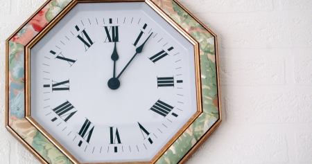 12 o'clock:  clock hanging on a wall