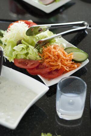 rakia: Fresh vegetable salad and oyzo