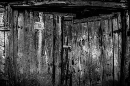 old wooden door black and white photo
