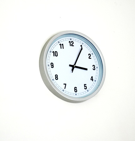 Clock hanging at the wall  photo