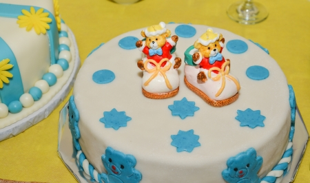 baby boy birthday cake with cute shoes photo