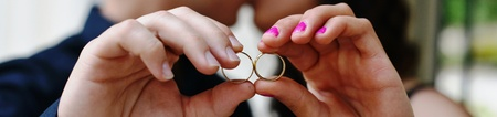 bride and groom showing wedding rings  photo