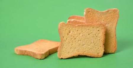 Toast bread on green background photo