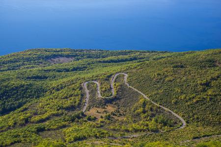 unsurfaced road: serpentine road, national park , galichitza,macedonia Stock Photo