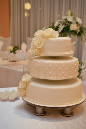 wedding cake with white roses Stock Photo