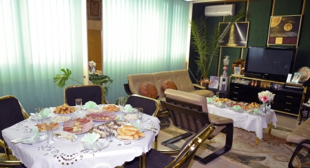 Spacious Living Room with food on a table waiting for the guests Stock Photo - 23761455