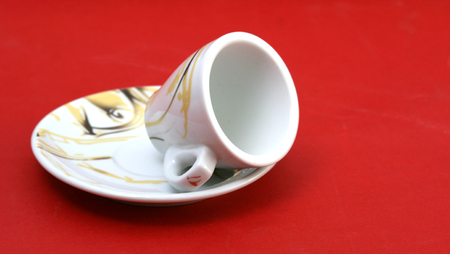 Empty coffee cup on a red background photo