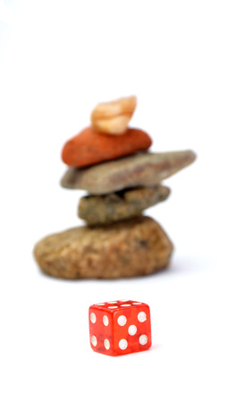 peace risk: Red dice and stones Stock Photo