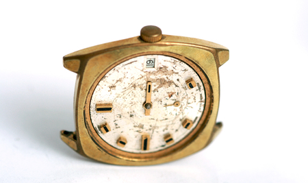 Old damaged wrist watch photo