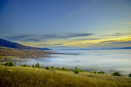Fog over Prespa valley in Macedonia photo