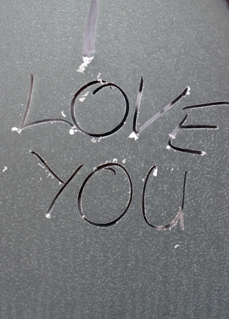 I love you text on frozen window photo