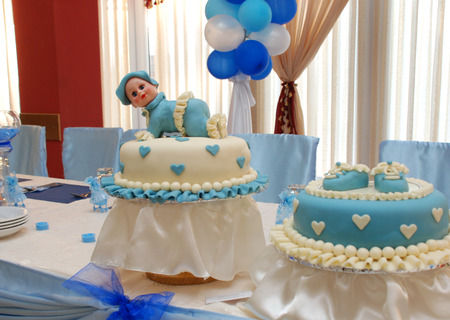 baby boy birthday cake with cute doll photo
