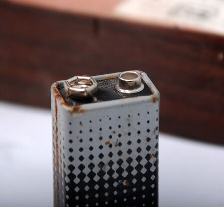 9v battery: 9 volt rusty battery Stock Photo
