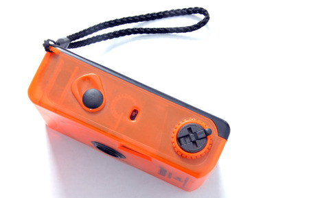 Old orange plastic compact film camera Stock Photo