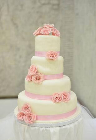 white wedding cake with roses photo