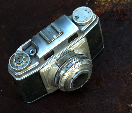 Vintage german camera on a rust background photo
