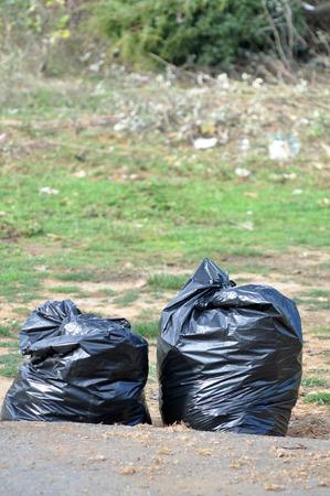 black garbage full of garbage  photo