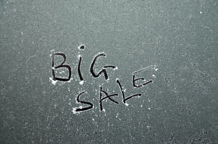 Big sale text on a frozen window photo