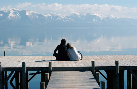 Romance on a wooden pier , Great Lake Prespa, Macedonia Banque d'images