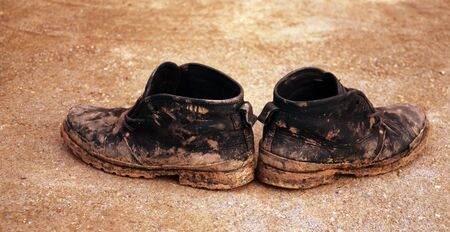 very dirty: dirty old shoes Stock Photo