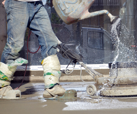 concreting: Picture of a workers smooth concreting the floor