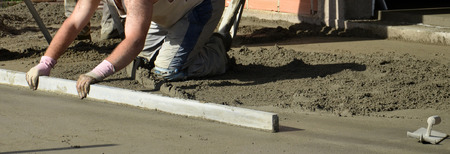 Picture of a workers smooth concreting the floor photo