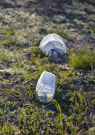 plastic pollution: Picture of a Plastic pollution, Plastic pet bottles in a grass
