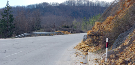 landslide: picture of a landslide of rocks on the asphalt road