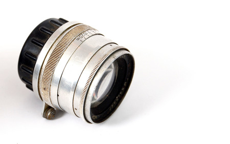 developper: An Old Manual Control Camera Lens Isolated On WhitePicture of a