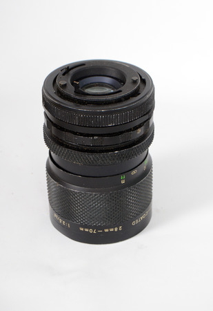 An Old Manual Control Camera Lens Isolated On White,Picture of a Stock Photo