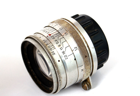 developper: An Old Manual Control Camera Lens Isolated On White,Picture of a Stock Photo
