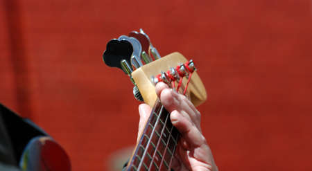 fingertips: Pictire of a guitarist plays