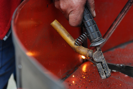 fabricator: Welding in manufacturing plant Stock Photo
