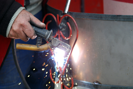 Welding in manufacturing plant Stock Photo