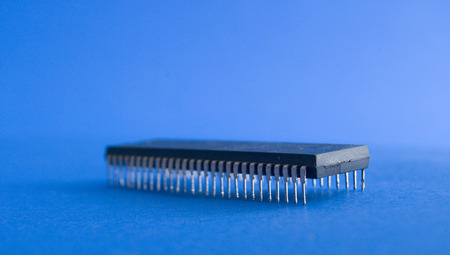 computer transistors: picture of a damaged transistors on blue background Stock Photo