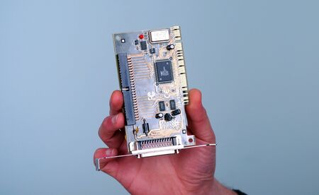 pci card: Picture of a male hand hold computer card