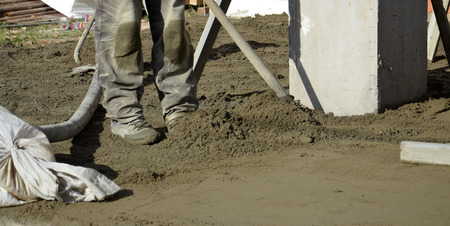 concreting: smooth concreting the floor, image of a worker Stock Photo